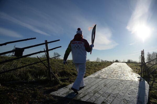 Участник эстафеты олимпийского огня