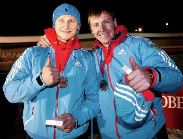 Российские бобслеисты Дмитрий Труненков и Александр Зубков (справа).