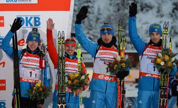Российские спортсмены Алексей Волков, Евгений Устюгов, Антон Шипулин и Дмитрий Малышко (слева направо)