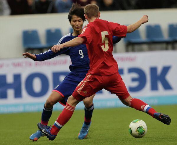 Игровой момент финального матча Россия - Япония