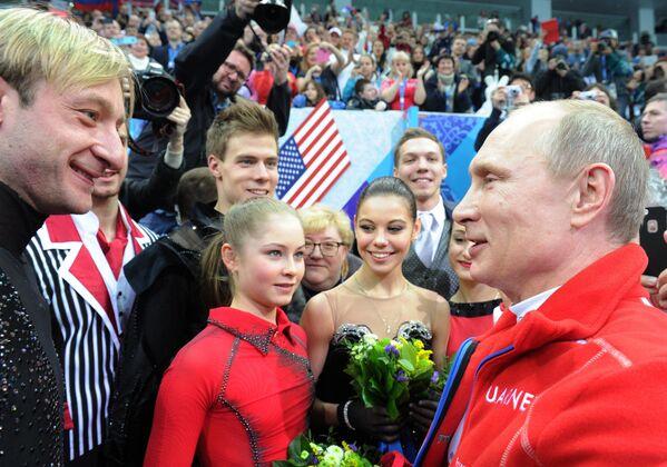 Евгений Плющенко (слева)