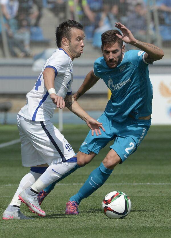 Полузащитник Динамо Матьё Вальбуэна (слева) и полузащитник Зенита Хави Гарсия